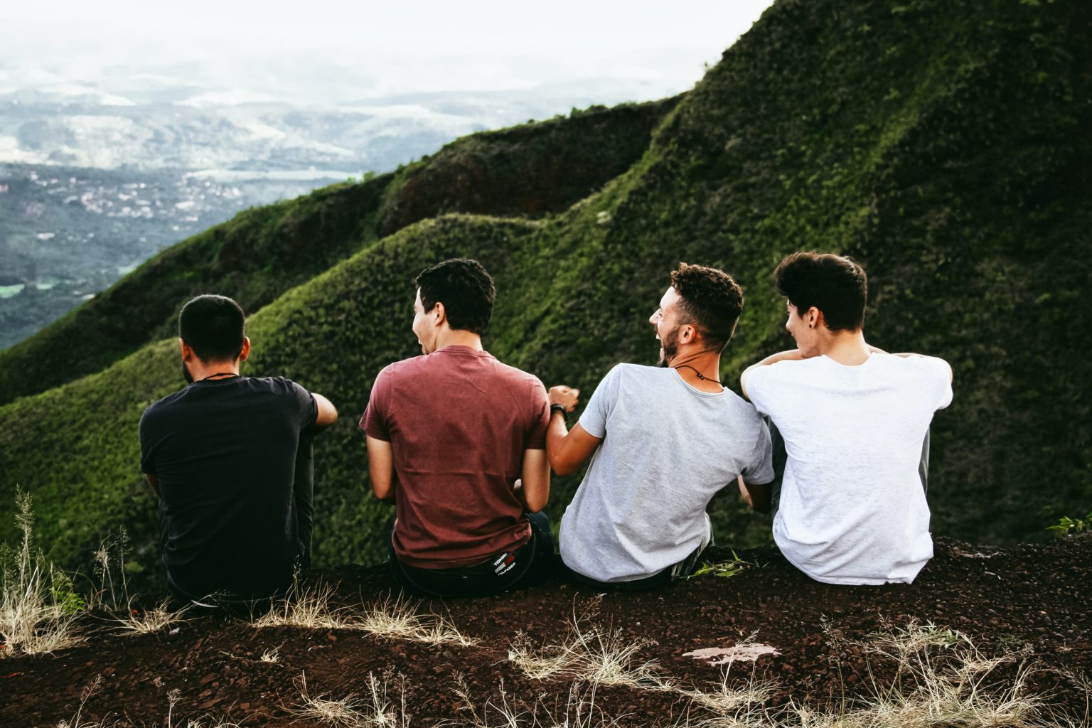 four friends looking out onto a valley